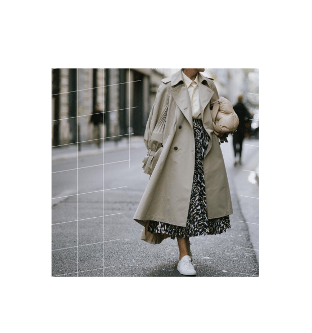 Woman with oversize beige trenchcoat - leopard midi skirt