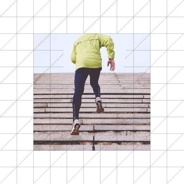 Man running up stairs - yellow softshell jacket - blue legging