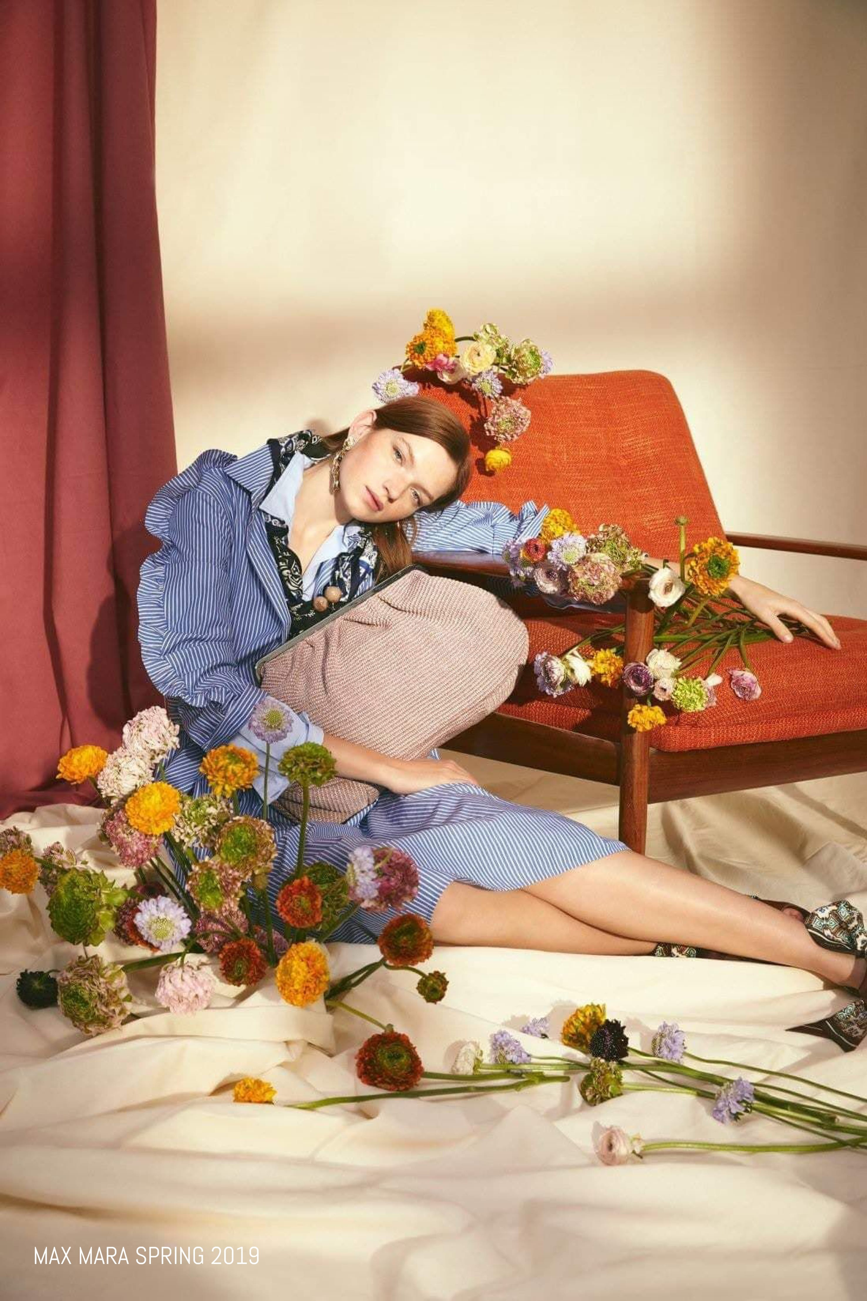 Model poses with flowers for Max Mara Spring 2018 campaign