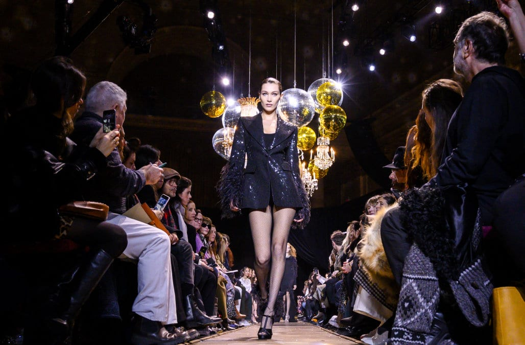Model Bella Hadid struts down the runway in all black.