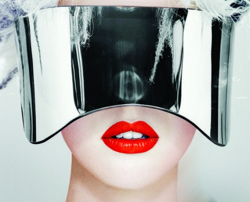 woman's face in red lipstick and ski glasses