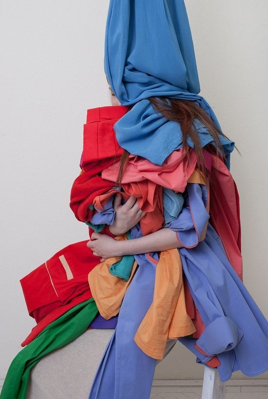 Model sits buried in pile of clothing