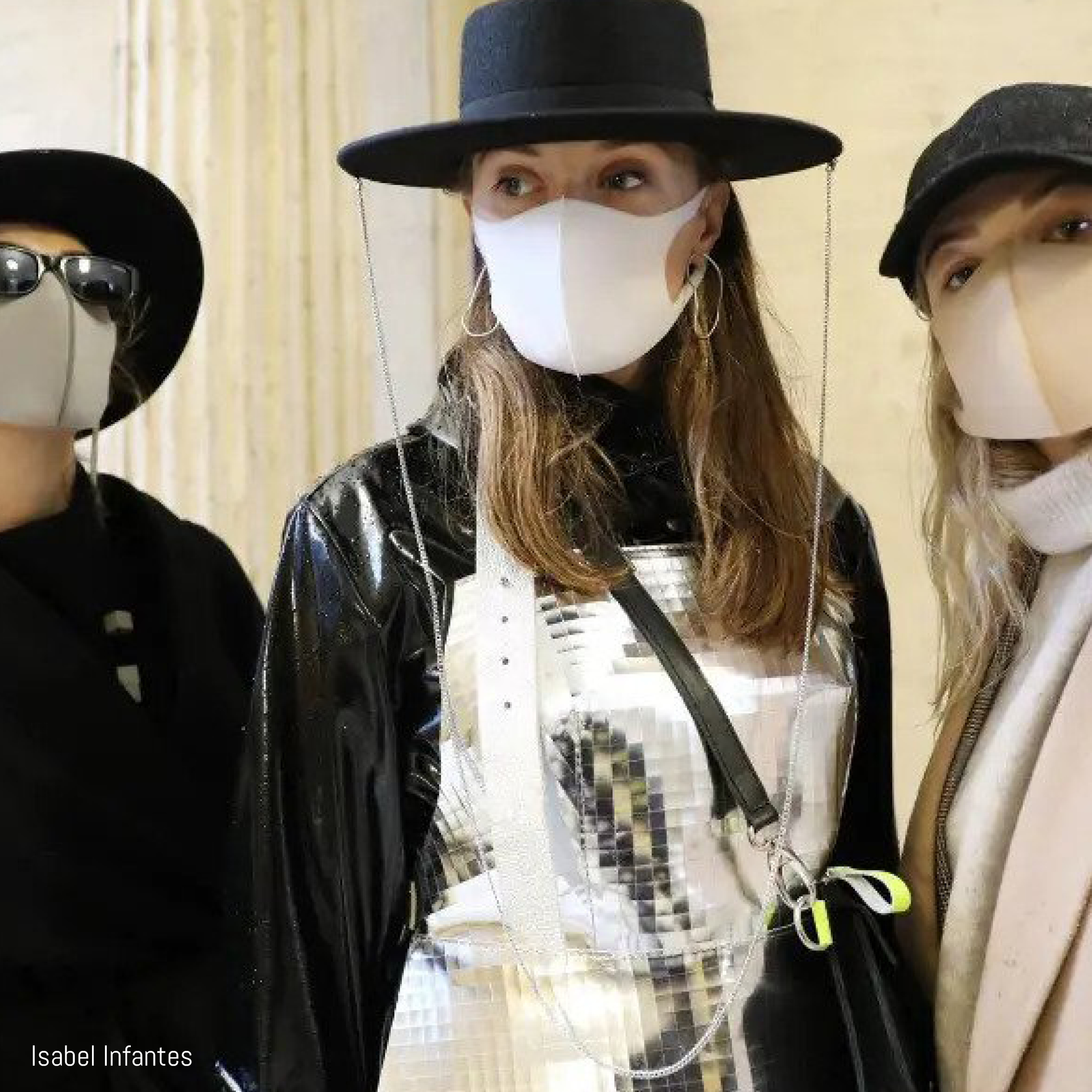 Three models pose in facemarks at London Fashion Week FW20