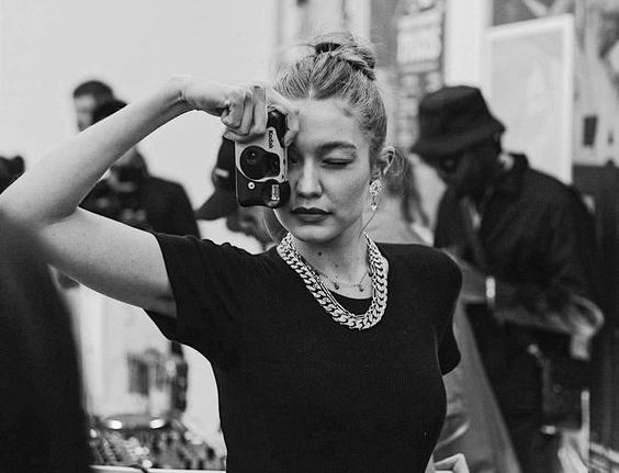 Model Gigi Hadid snaps a photo