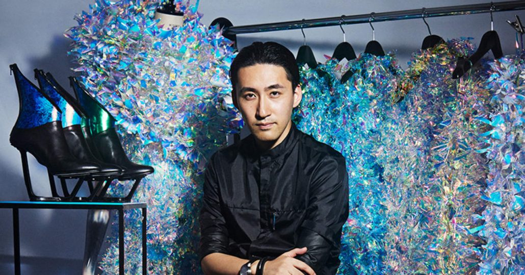 Yuima Nakazato in front of his AI designs