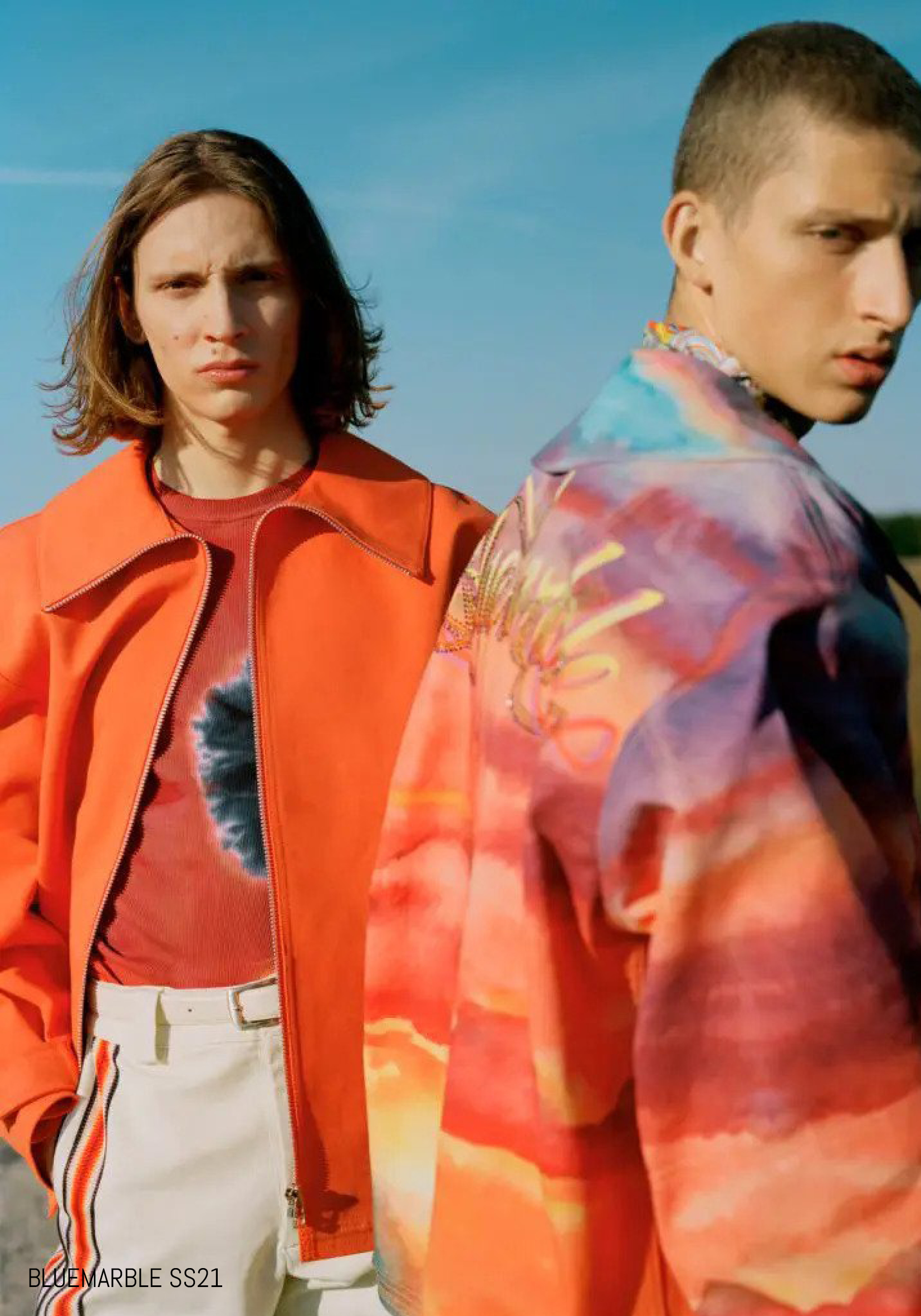 Male models pose in orange and tie dye outerwear for BLUEMARBLE SS21
