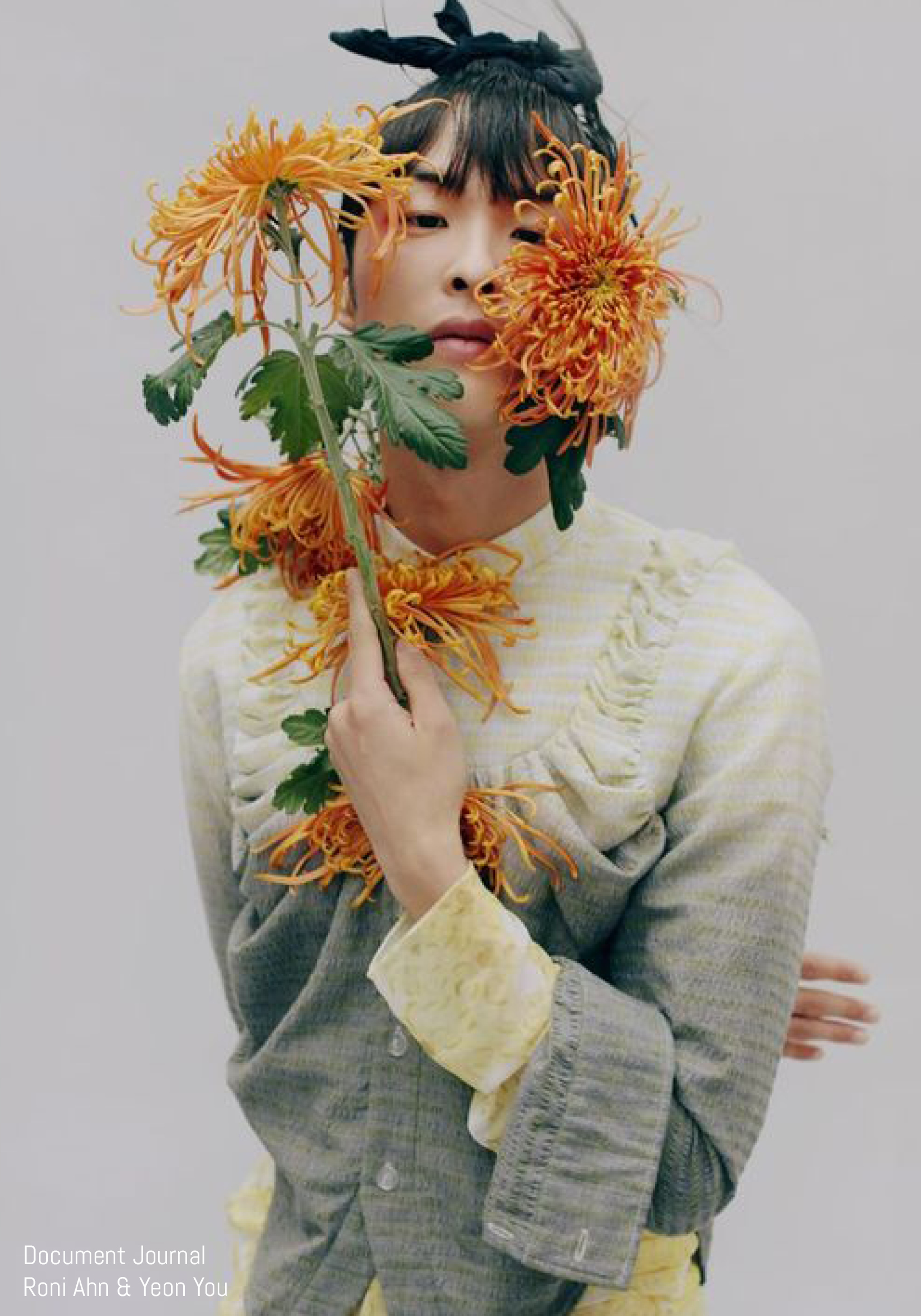 Model poses with flower bouquet for Document Journal Roni Ahn & Yeon You
