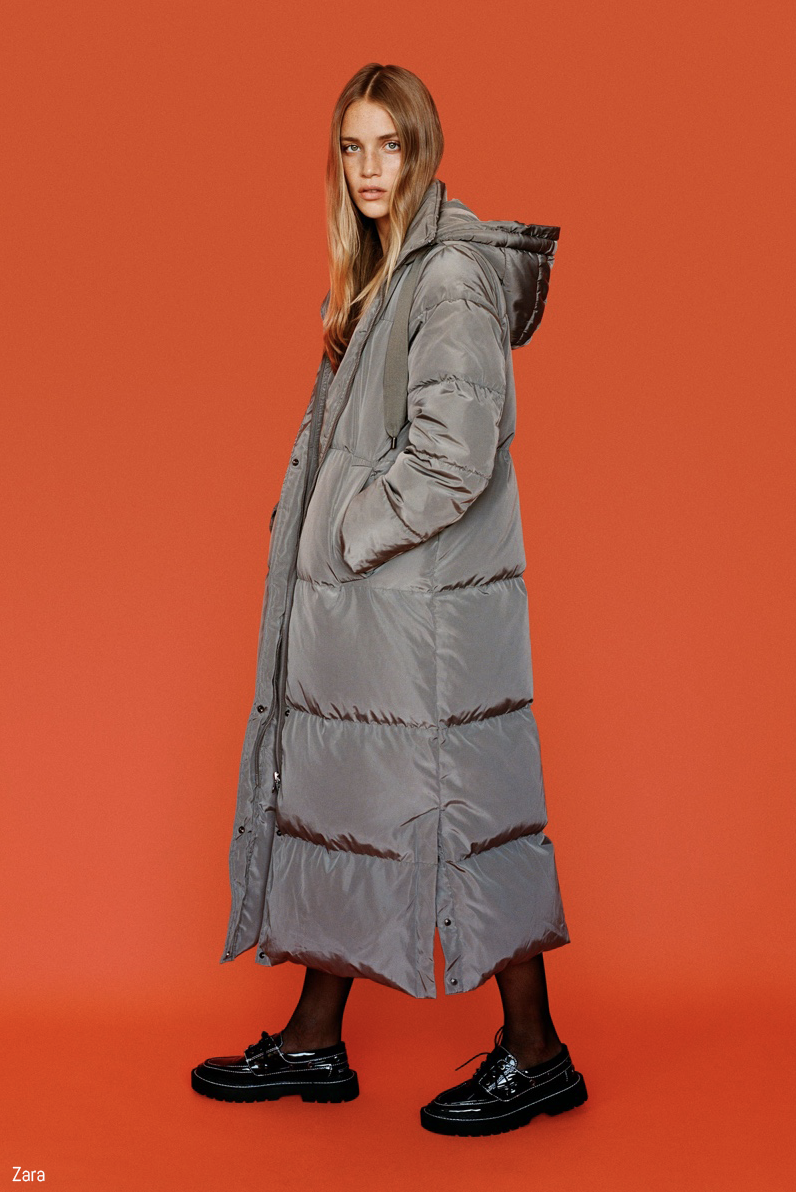 Model poses in long grey puffer jacket for Zara