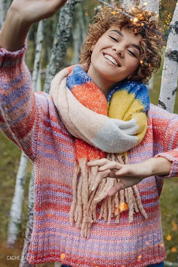 Model poses in knit sweater for Cache Cache lookbook