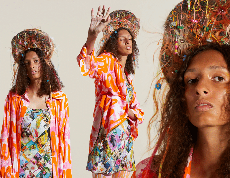 Model poses for Collina Strada's SS21 RTW collection in a psychedelic print shirt jacket