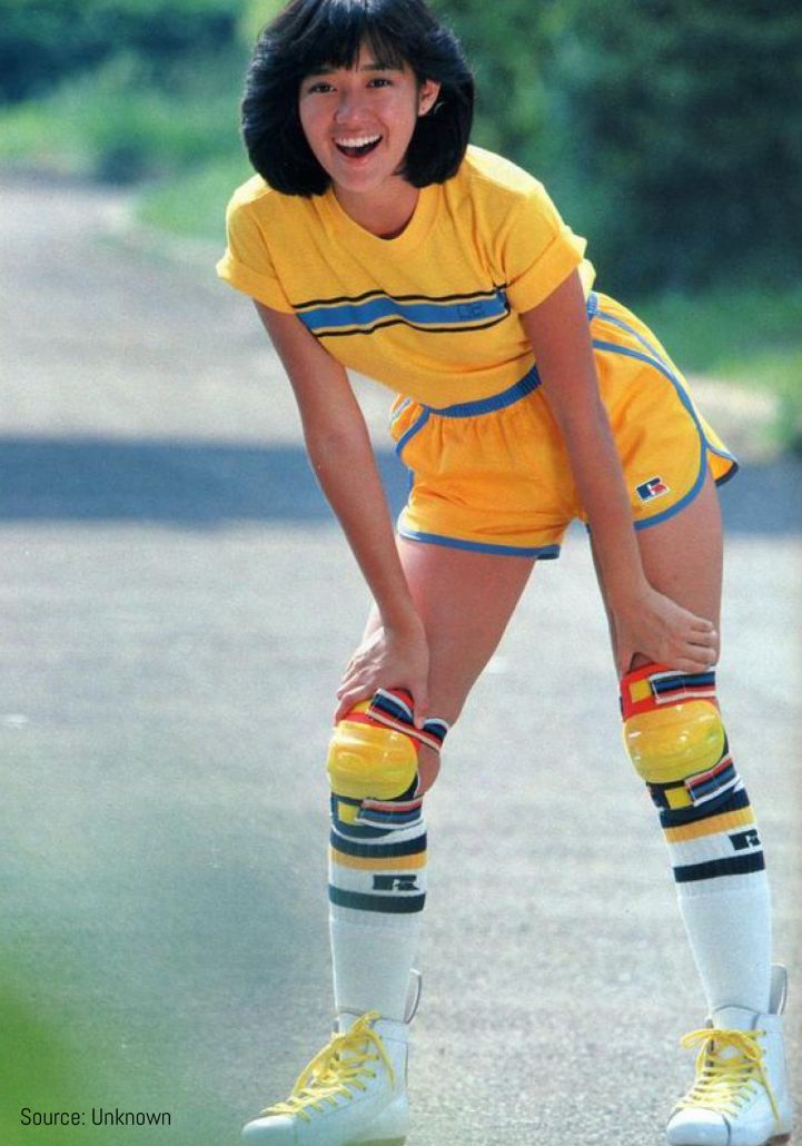 Model poses in activewear in rollerblades