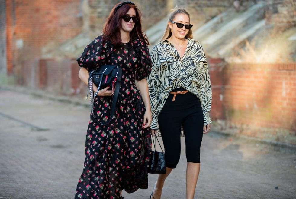 Two street stylers strut in a maxi dress and fitted black capri pants