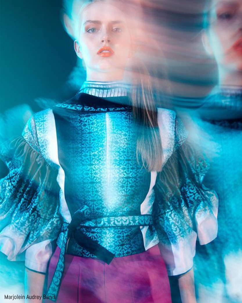 Model poses in futuristic wear, shot by Marjolein Audrey Banis