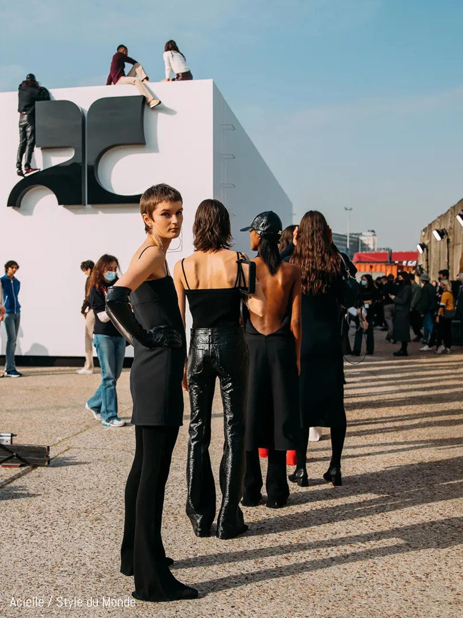 Models line up outside of the FW21 Courreges show