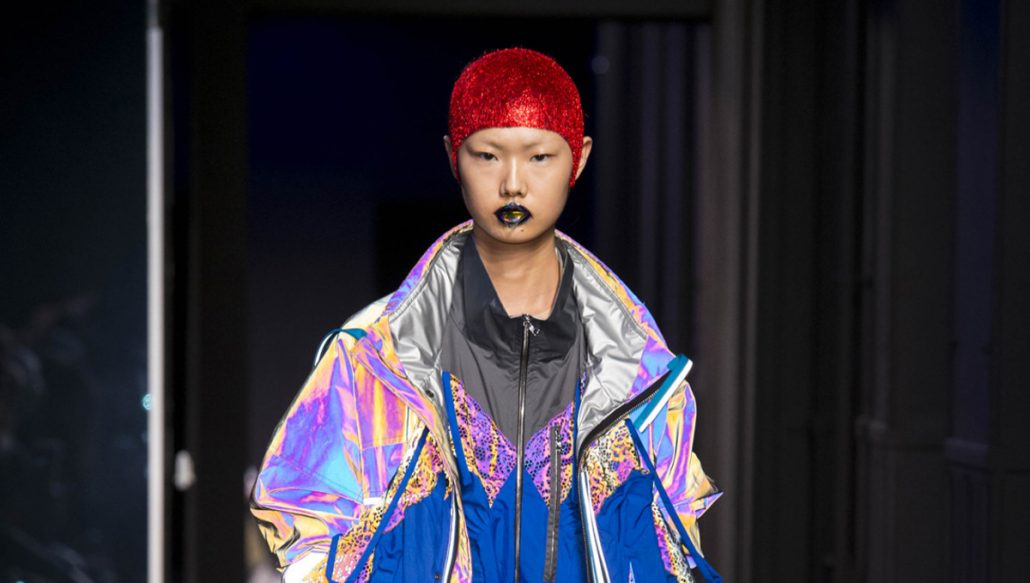 Model in fluo reflective clothing for Margiela 2018 Spring Couture