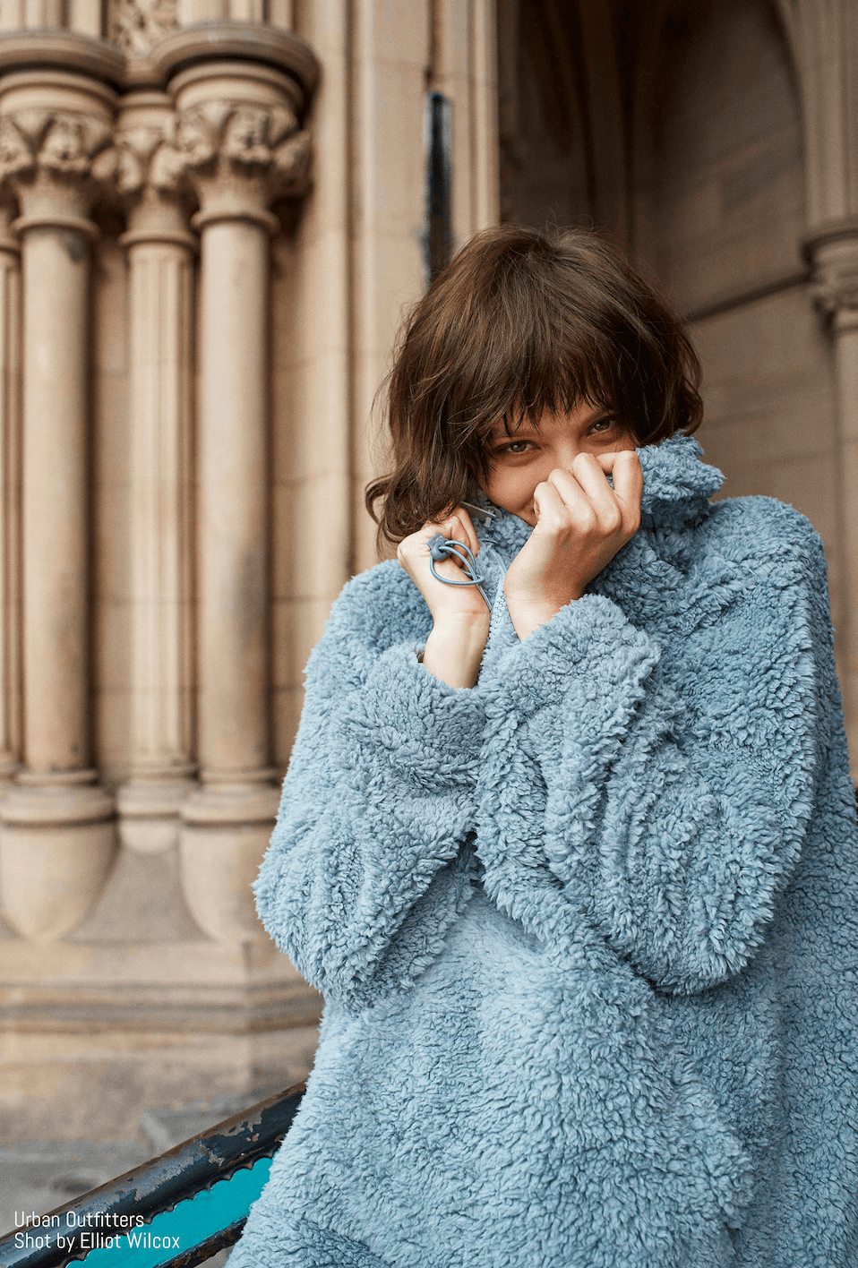 Model poses in blue UO fuzzy jumper