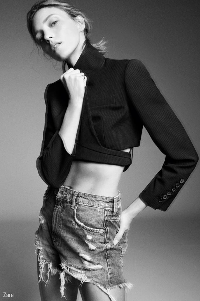 Model poses in cropped blazer and denim shorts for Zara