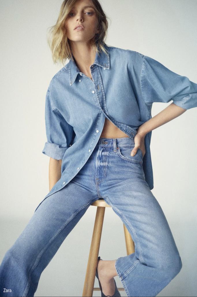 Model poses in blue denim chemise and jeans for Zara