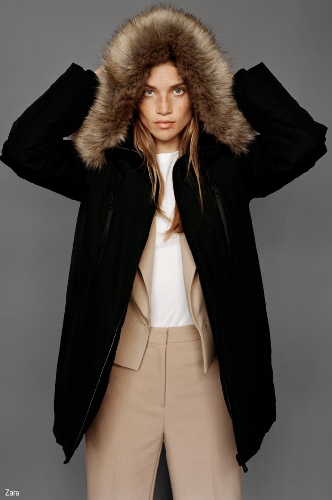 Model poses in fur-lined hooded coat for Zara