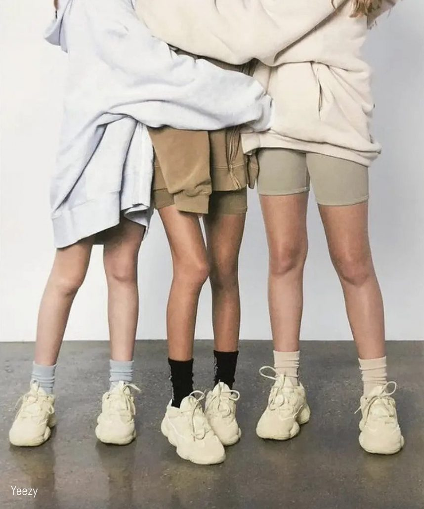 Models pose in Yeezy athleisure