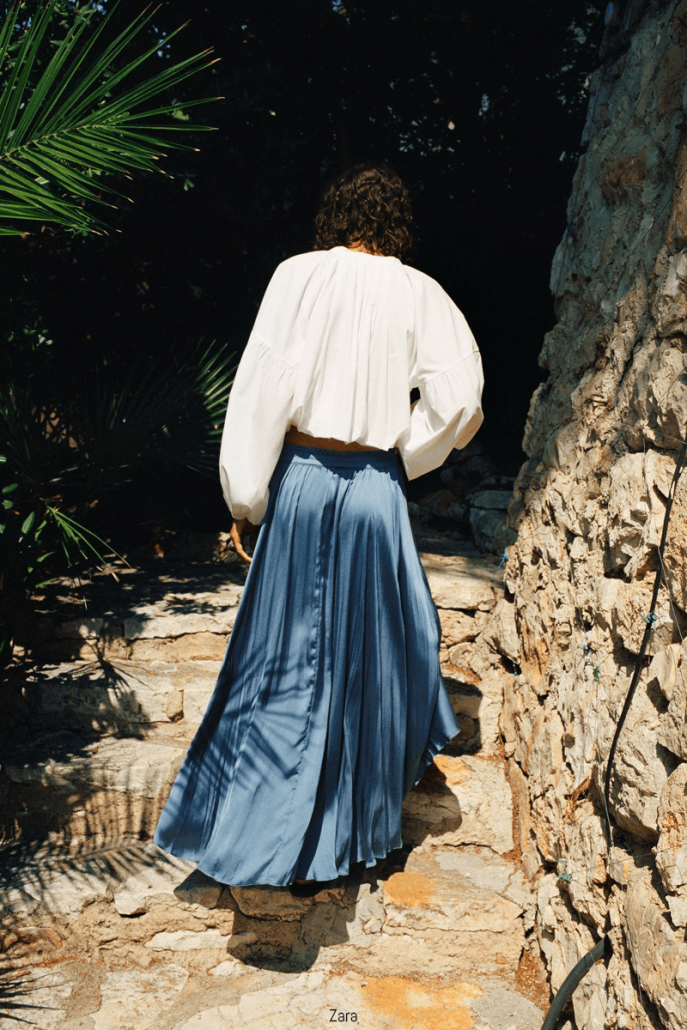 Model wears a maxi silk skirt and white chemise for Zara Summer Vacation Campaign 2020