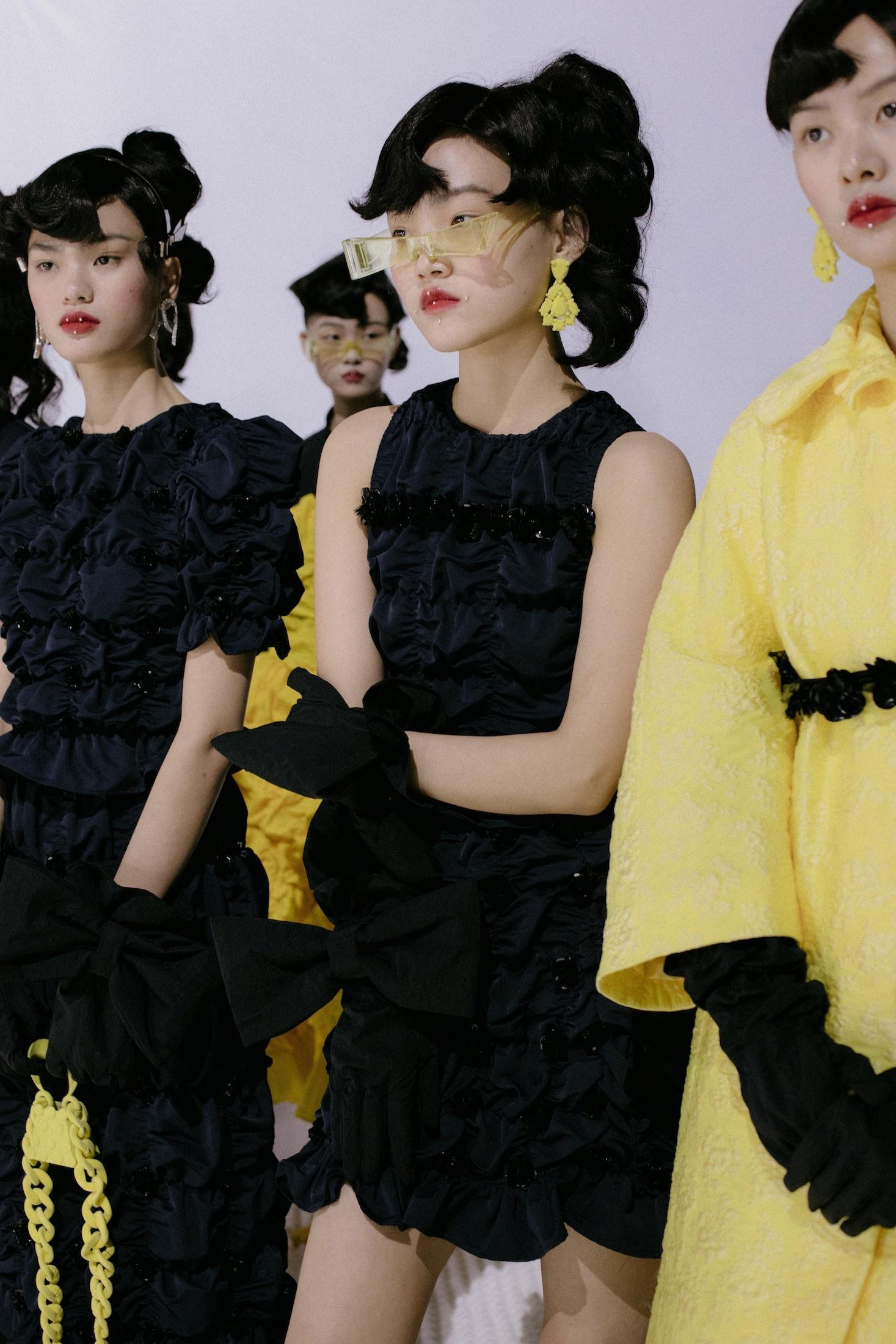 Models wait backstage at Shushu/Tong FW21