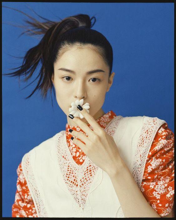 Model poses for Harper's Bazaar China