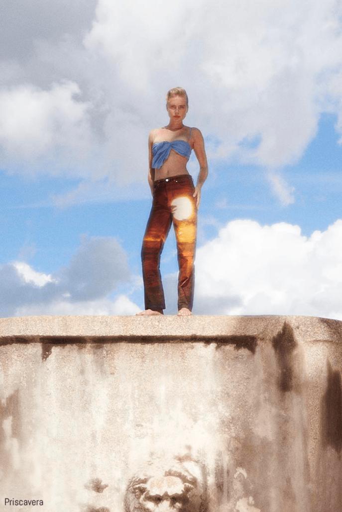 model poses in bleached denim for priscavera