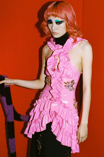Model poses in bright pink for Louis Shengtao Chen FW21