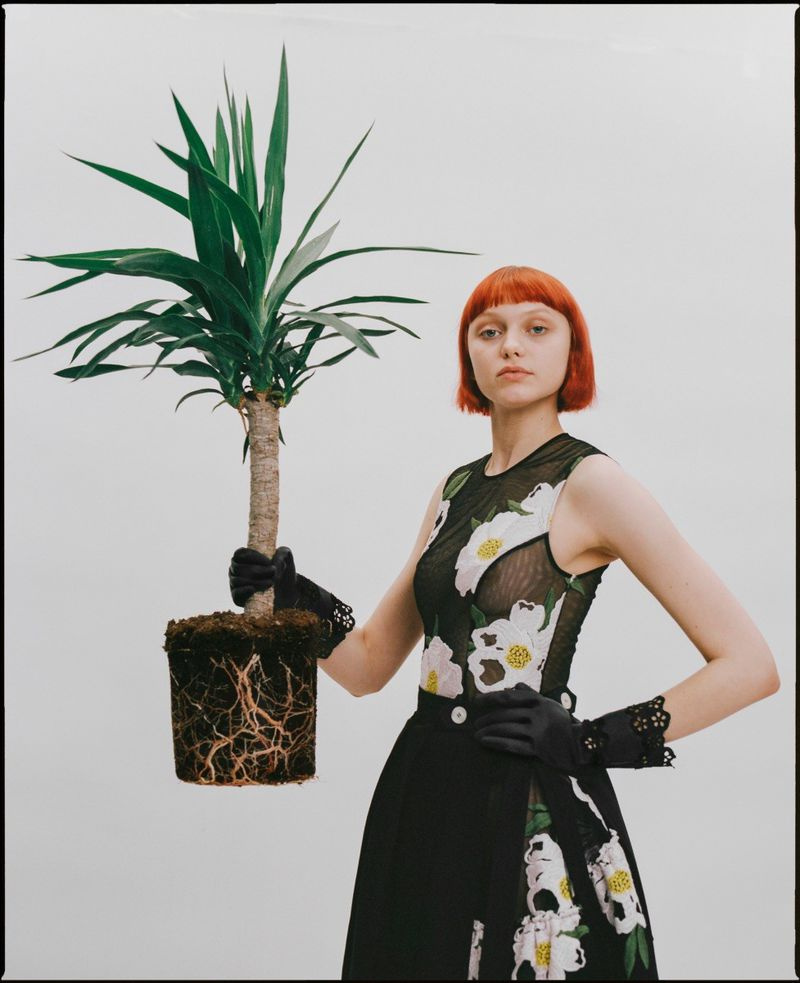 Model poses with plant for Pap Magazine