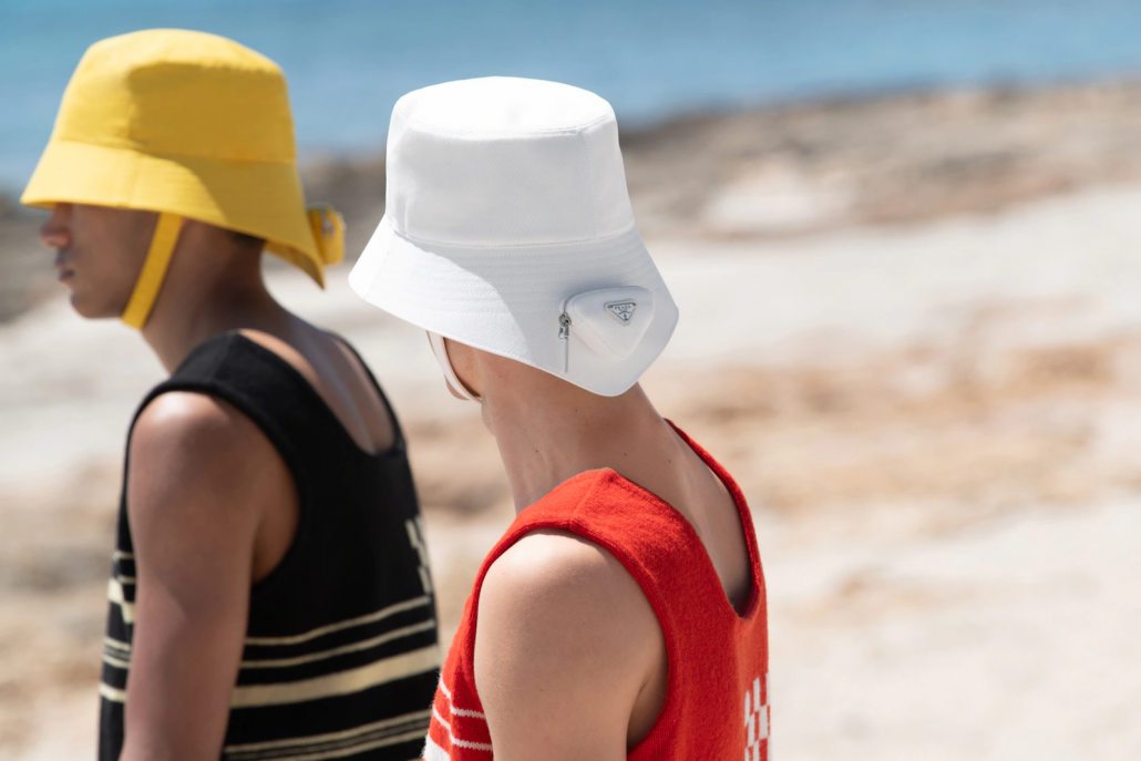 Model pose in bucket hats for Prada Spring 2022 Men's Collection