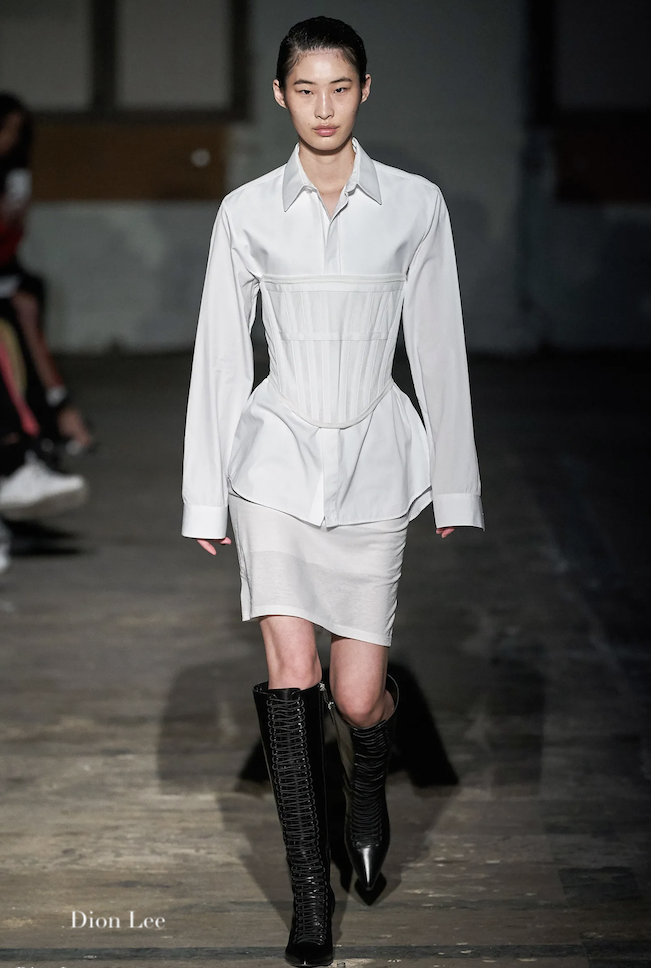model in runway with white corset